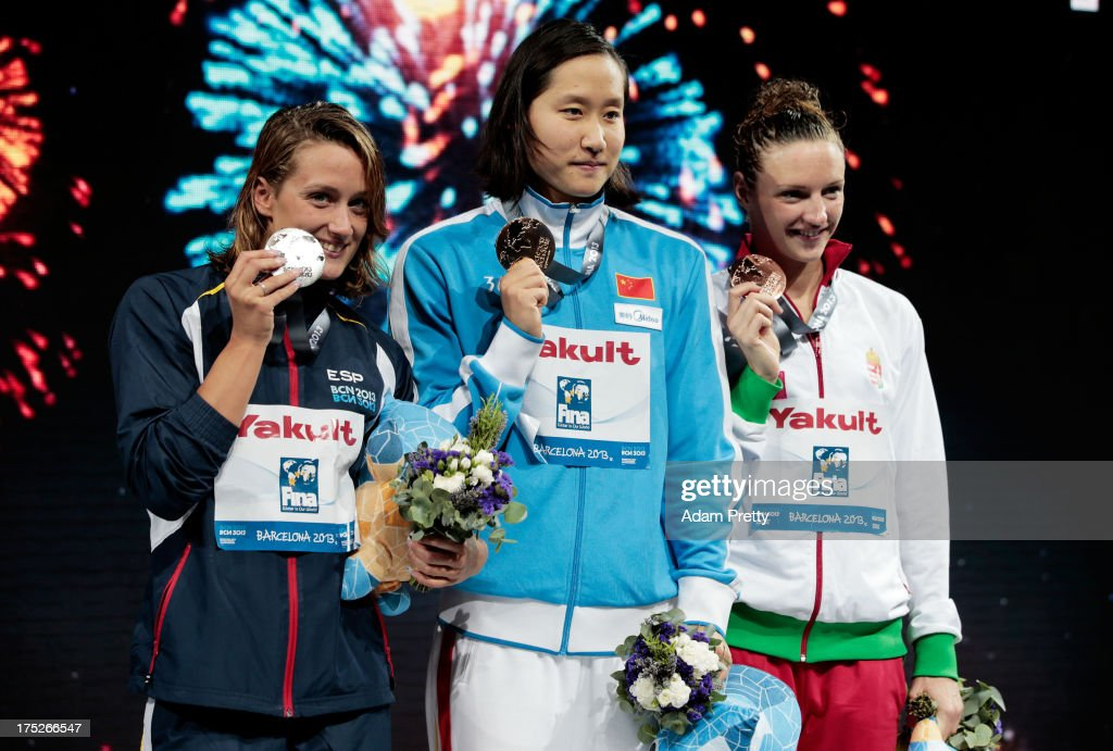 Silver medal winner <a gi-track='captionPersonalityLinkClicked' href=/galleries/search?phrase=Mireia+Belmonte&family=editorial&specificpeople=5120453 ng-click='$event.stopPropagation()'>Mireia Belmonte</a> Garcia of Spain, Gold medal winner Zige Liu of China and <a gi-track='captionPersonalityLinkClicked' href=/galleries/search?phrase=Katinka+Hosszu&family=editorial&specificpeople=2124249 ng-click='$event.stopPropagation()'>Katinka Hosszu</a> of Hungary celebrate on the podium after the Swimming Women's Butterfly 200m Final on day thirteen of the 15th FINA World Championships at Palau Sant Jordi on August 1, 2013 in Barcelona, Spain.
