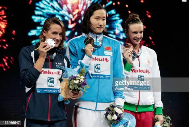 Silver medal winner Mireia Belmonte Garcia of Spain Gold medal winner Zige Liu of China and Katinka Hosszu of Hungary celebrate on the podium after...