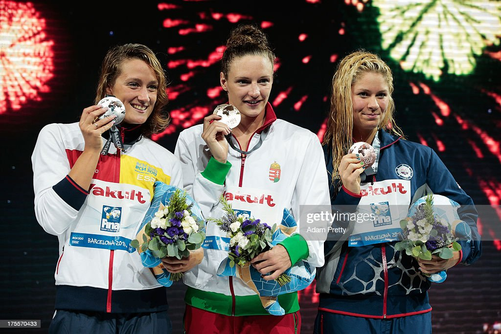 Silver medal winner <a gi-track='captionPersonalityLinkClicked' href=/galleries/search?phrase=Mireia+Belmonte&family=editorial&specificpeople=5120453 ng-click='$event.stopPropagation()'>Mireia Belmonte</a> Garcia of Spain, Gold medal winner <a gi-track='captionPersonalityLinkClicked' href=/galleries/search?phrase=Katinka+Hosszu&family=editorial&specificpeople=2124249 ng-click='$event.stopPropagation()'>Katinka Hosszu</a> of Hungary and Bronze medal winner <a gi-track='captionPersonalityLinkClicked' href=/galleries/search?phrase=Elizabeth+Beisel&family=editorial&specificpeople=4651274 ng-click='$event.stopPropagation()'>Elizabeth Beisel</a> of the USA celebrate on the podium after the Swimming Women's Individual Medley 400m Final on day sixteen of the 15th FINA World Championships at Palau Sant Jordi on August 4, 2013 in Barcelona, Spain.