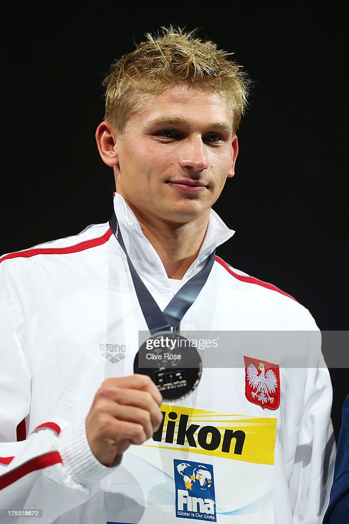 Silver medal winner Radoslaw Kawecki of Poland celebrates on the podium after the Swimming Men's Backstroke 200m Final on day fourteen of the 15th FINA World Championships at Palau Sant Jordi on August 2, 2013 in Barcelona, Spain.