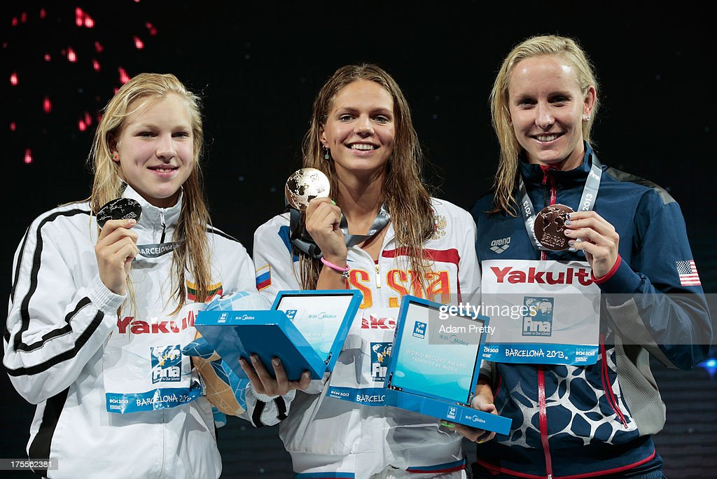 Silver medal winner Ruta Meilutyte of Lithuania, Gold medal winner Yuliya Efimova of Russia and Bronze medal winner <a gi-track='captionPersonalityLinkClicked' href=/galleries/search?phrase=Jessica+Hardy&family=editorial&specificpeople=540355 ng-click='$event.stopPropagation()'>Jessica Hardy</a> of the USA celebrate on the podium after the Swimming Women's Breaststroke 50m Final on day sixteen of the 15th FINA World Championships at Palau Sant Jordi on August 4, 2013 in Barcelona, Spain.