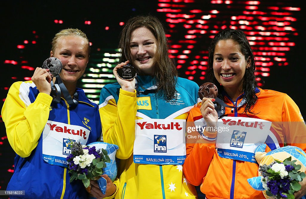 Silver medal winner <a gi-track='captionPersonalityLinkClicked' href=/galleries/search?phrase=Sarah+Sjostrom&family=editorial&specificpeople=6000292 ng-click='$event.stopPropagation()'>Sarah Sjostrom</a> of Sweden, Gold medal winner <a gi-track='captionPersonalityLinkClicked' href=/galleries/search?phrase=Cate+Campbell&family=editorial&specificpeople=4115465 ng-click='$event.stopPropagation()'>Cate Campbell</a> of Australia and Bronze medal winner <a gi-track='captionPersonalityLinkClicked' href=/galleries/search?phrase=Ranomi+Kromowidjojo&family=editorial&specificpeople=4209840 ng-click='$event.stopPropagation()'>Ranomi Kromowidjojo</a> of the Netherlands celebrate on the podium after the Swimming Women's Freestyle 100m Final on day fourteen of the 15th FINA World Championships at Palau Sant Jordi on August 2, 2013 in Barcelona, Spain.