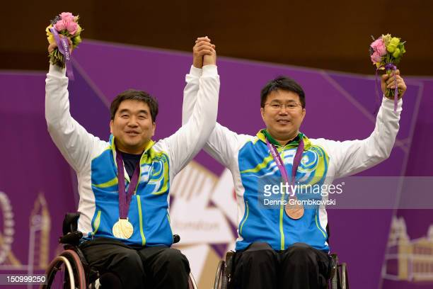 Silver medal winner Seakyun Park of Republic of Korea and teammate and bronze medal winner Juhee Lee celebrate after the Men's P110m Air Pistol SH1...