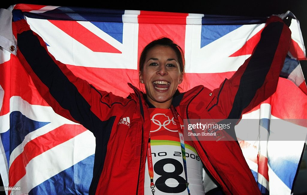 Silver Medal winner Shelley Rudman of Great Britain celebrates with a flag after the Womens Skeleton Single Final on Day 6 of the 2006 Turin Winter...