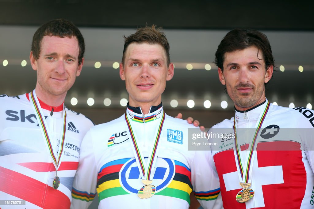 Silver medal winner Sir <a gi-track='captionPersonalityLinkClicked' href=/galleries/search?phrase=Bradley+Wiggins&family=editorial&specificpeople=182490 ng-click='$event.stopPropagation()'>Bradley Wiggins</a> of Great Britain, gold medal winner <a gi-track='captionPersonalityLinkClicked' href=/galleries/search?phrase=Tony+Martin+-+Cyclist&family=editorial&specificpeople=5399396 ng-click='$event.stopPropagation()'>Tony Martin</a> of Germany and bronze medal winner <a gi-track='captionPersonalityLinkClicked' href=/galleries/search?phrase=Fabian+Cancellara&family=editorial&specificpeople=573515 ng-click='$event.stopPropagation()'>Fabian Cancellara</a> of Switzerland pose on the podium after the Elite Men's Time Trial, from Montecatini Terme to Florence on September 25, 2013 in Florence, Italy.