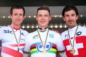 Silver medal winner Sir Bradley Wiggins of Great Britain gold medal winner Tony Martin of Germany and bronze medal winner Fabian Cancellara of...