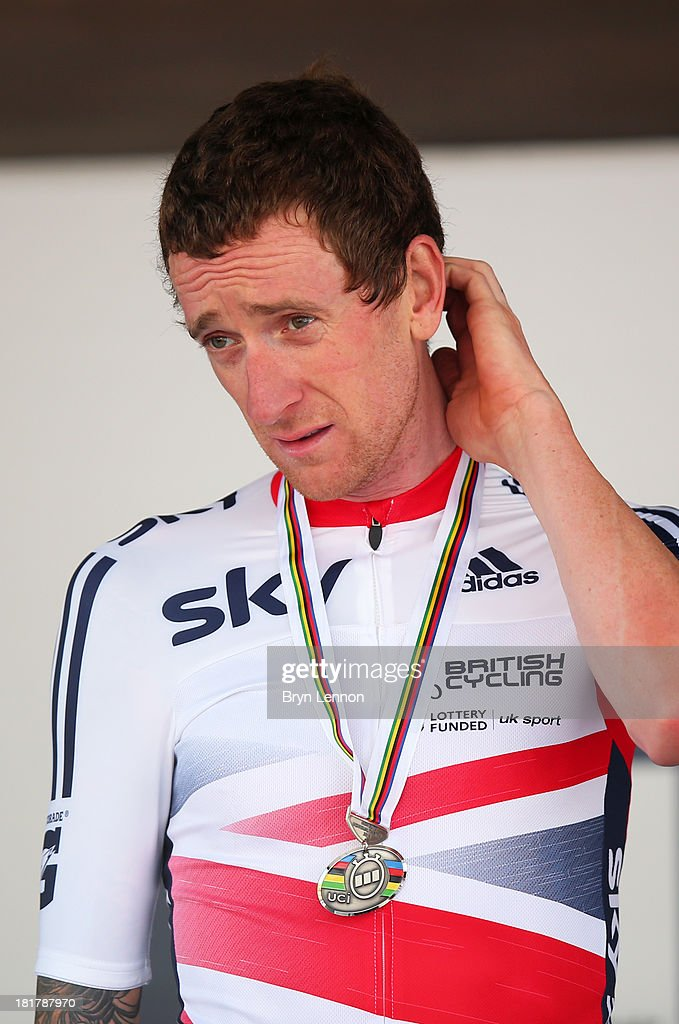 Silver medal winner Sir Bradley Wiggins of Great Britain poses on the podium after the Elite Men's Time Trial, from Montecatini Terme to Florence on September 25, 2013 in Florence, Italy.