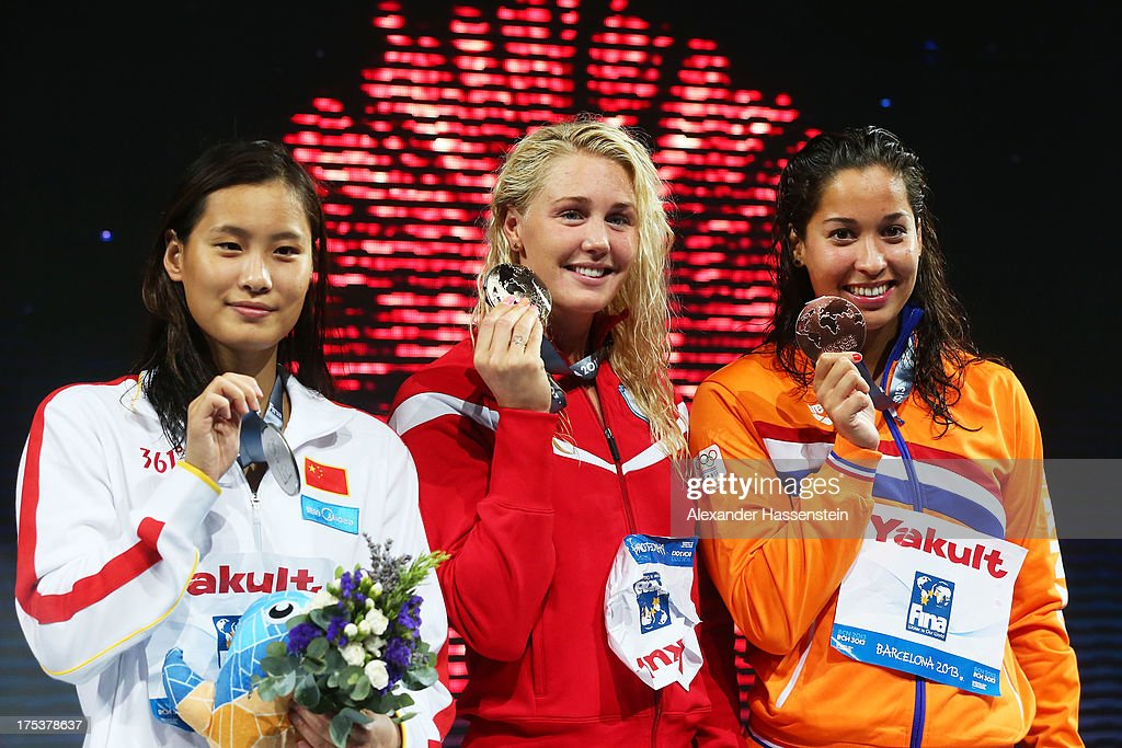 Silver medal winner Ying Lu of China, Gold medal winner Jeanette Otteesn Gray of Denmark and Bronze medal winner Ranomi Kromowidjojo of the Netherlands celebrate on the podium after the Swimming Women's Butterfly 50m Final on day fifteen of the 15th FINA World Championships at Palau Sant Jordi on August 3, 2013 in Barcelona, Spain.