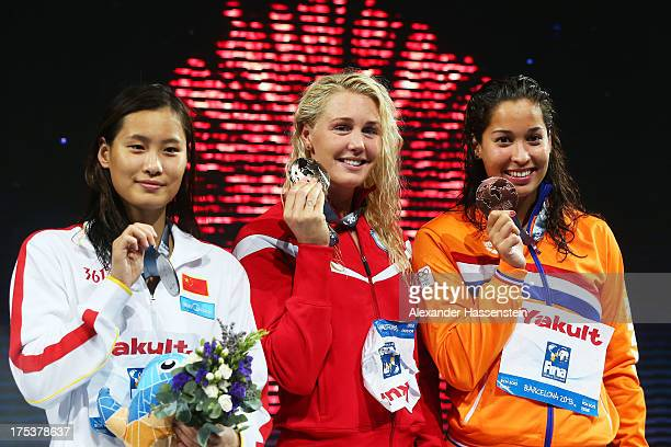 Silver medal winner Ying Lu of China Gold medal winner Jeanette Otteesn Gray of Denmark and Bronze medal winner Ranomi Kromowidjojo of the...