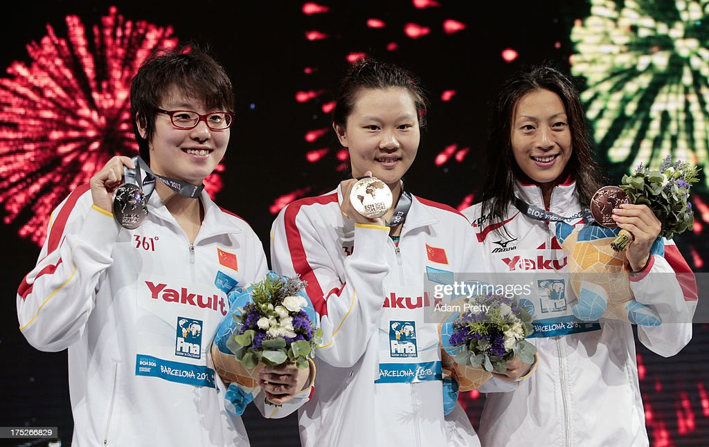 Silver medal winner Yuanhui Fu of China, Gold medal winner Jing Zhao of China and Bronze medal winner <a gi-track='captionPersonalityLinkClicked' href=/galleries/search?phrase=Aya+Terakawa&family=editorial&specificpeople=2167954 ng-click='$event.stopPropagation()'>Aya Terakawa</a> of Japan celebrate on the podium after the Swimming Women's Backstroke 50m Final on day thirteen of the 15th FINA World Championships at Palau Sant Jordi on August 1, 2013 in Barcelona, Spain.