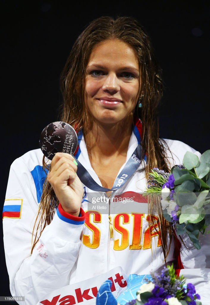Silver medal winner Yuliya Efimova of Russia celebrates on the podium after the Swimming Women's 100m Breastroke Final on day eleven of the 15th FINA World Championships at Palau Sant Jordi on July 30, 2013 in Barcelona, Spain.