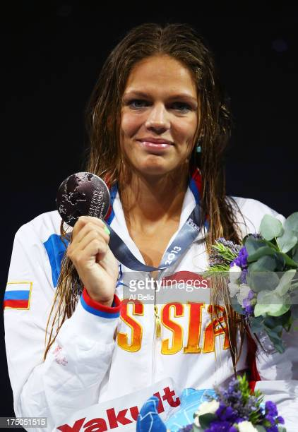 Silver medal winner Yuliya Efimova of Russia celebrates on the podium after the Swimming Women's 100m Breastroke Final on day eleven of the 15th FINA...