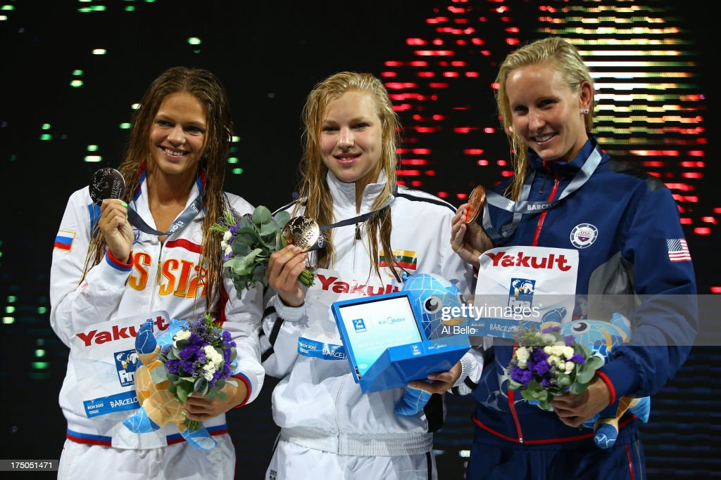Silver medal winner Yuliya Efimova of Russia, Gold medal winner <a gi-track='captionPersonalityLinkClicked' href=/galleries/search?phrase=Ruta+Meilutyte&family=editorial&specificpeople=7539009 ng-click='$event.stopPropagation()'>Ruta Meilutyte</a> of Lithuania and Bronze medal winner <a gi-track='captionPersonalityLinkClicked' href=/galleries/search?phrase=Jessica+Hardy&family=editorial&specificpeople=540355 ng-click='$event.stopPropagation()'>Jessica Hardy</a> of the USA celebrate on the podium after the Swimming Women's 100m Breastroke Final on day eleven of the 15th FINA World Championships at Palau Sant Jordi on July 30, 2013 in Barcelona, Spain.