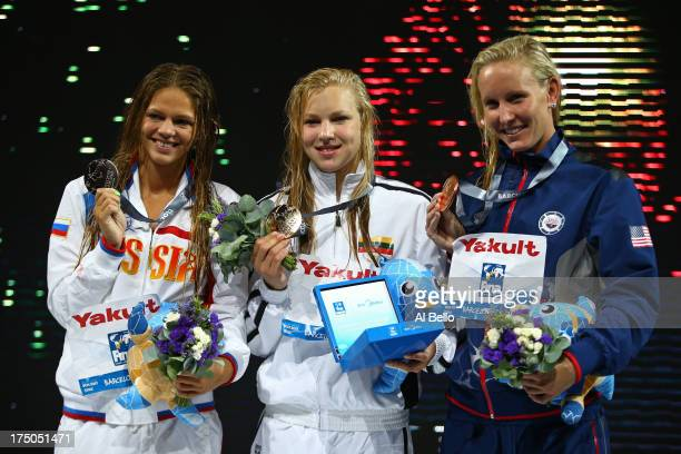 Silver medal winner Yuliya Efimova of Russia Gold medal winner Ruta Meilutyte of Lithuania and Bronze medal winner Jessica Hardy of the USA celebrate...