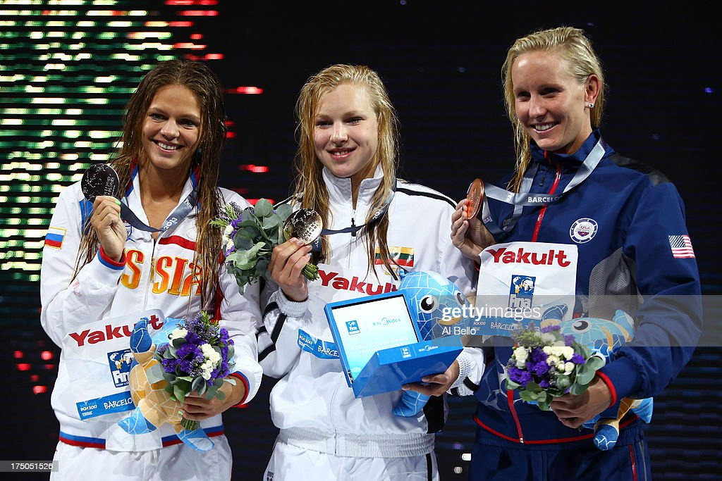 Silver medal winner Yuliya Efimova of Russia, Gold medal winner Ruta Meilutyte of Lithuania and Bronze medal winner Jessica Hardy of the USA celebrate on the podium after the Swimming Women's 100m Breastroke Final on day eleven of the 15th FINA World Championships at Palau Sant Jordi on July 30, 2013 in Barcelona, Spain.