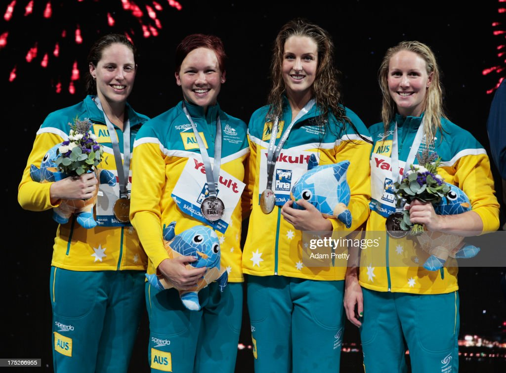 Silver medal winners <a gi-track='captionPersonalityLinkClicked' href=/galleries/search?phrase=Alicia+Coutts&family=editorial&specificpeople=2905127 ng-click='$event.stopPropagation()'>Alicia Coutts</a>, <a gi-track='captionPersonalityLinkClicked' href=/galleries/search?phrase=Kylie+Palmer&family=editorial&specificpeople=635542 ng-click='$event.stopPropagation()'>Kylie Palmer</a>, Brittany Elmslie and Bronte Barratt of Australia celebrate on the podium after the Swimming Women's Freestyle 4x200m Final on day thirteen of the 15th FINA World Championships at Palau Sant Jordi on August 1, 2013 in Barcelona, Spain.