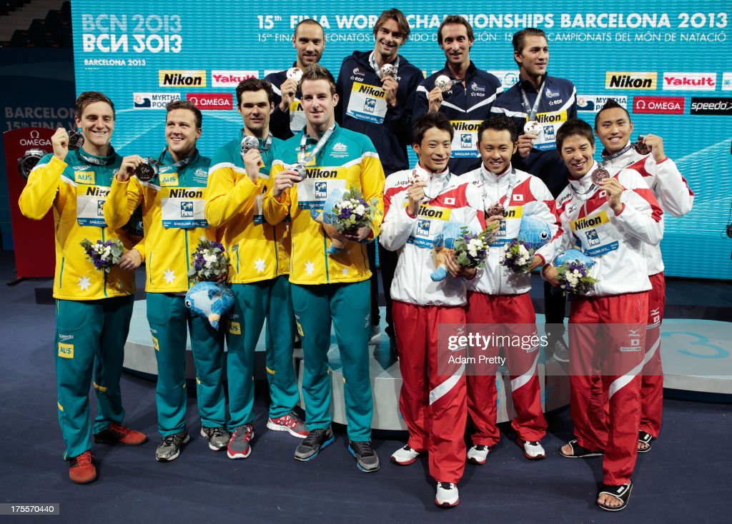 Silver medal winners Australia, Gold medal winners France and Bronze medal winners Japan celebrate on the podium after the Swimming Men's Medley 4x100m Relay Final on day sixteen of the 15th FINA World Championships at Palau Sant Jordi on August 4, 2013 in Barcelona, Spain.
