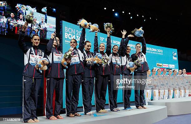 Silver medal winners Spain celebrate on the podium after the Synchronized Swimming Team Free Final on day seven of the 15th FINA World Championships...