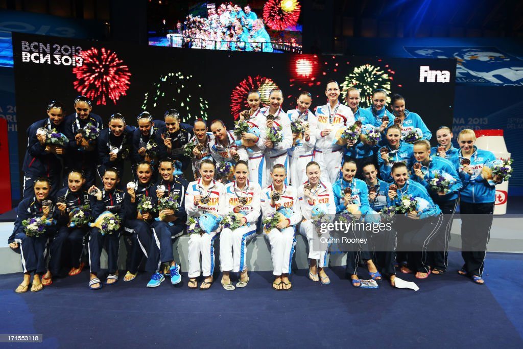 Silver medal winners Spain, Gold medal winners Russia and Bronze medal winners Ukraine celebrate after during the Synchronized Swimming Free Combination Final on day eight of the 15th FINA World Championships at Palau Sant Jordi on July 27, 2013 in Barcelona, Spain.