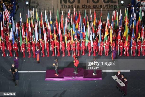 Silver medalist Abel Kirui of Kenya gold medalist Stephen Kiprotich of Uganda and bronze medalist Wilson Kipsang Kiprotich of Kenya celebrate on the...