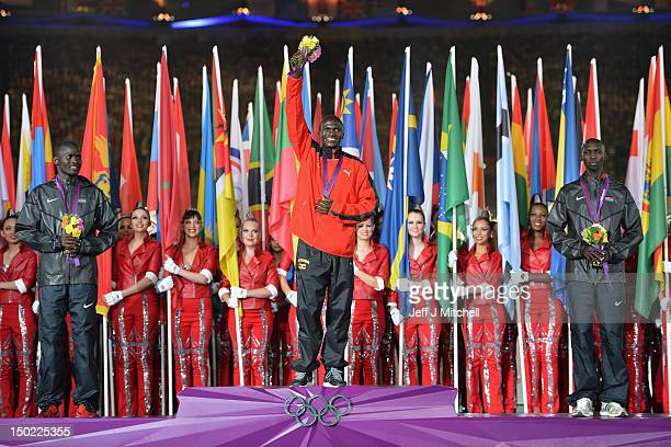 Silver medalist Abel Kirui of Kenya gold medalist Stephen Kiprotich of Uganda and bronze medalist Wilson Kipsang Kiprotich of Kenya pose on the...
