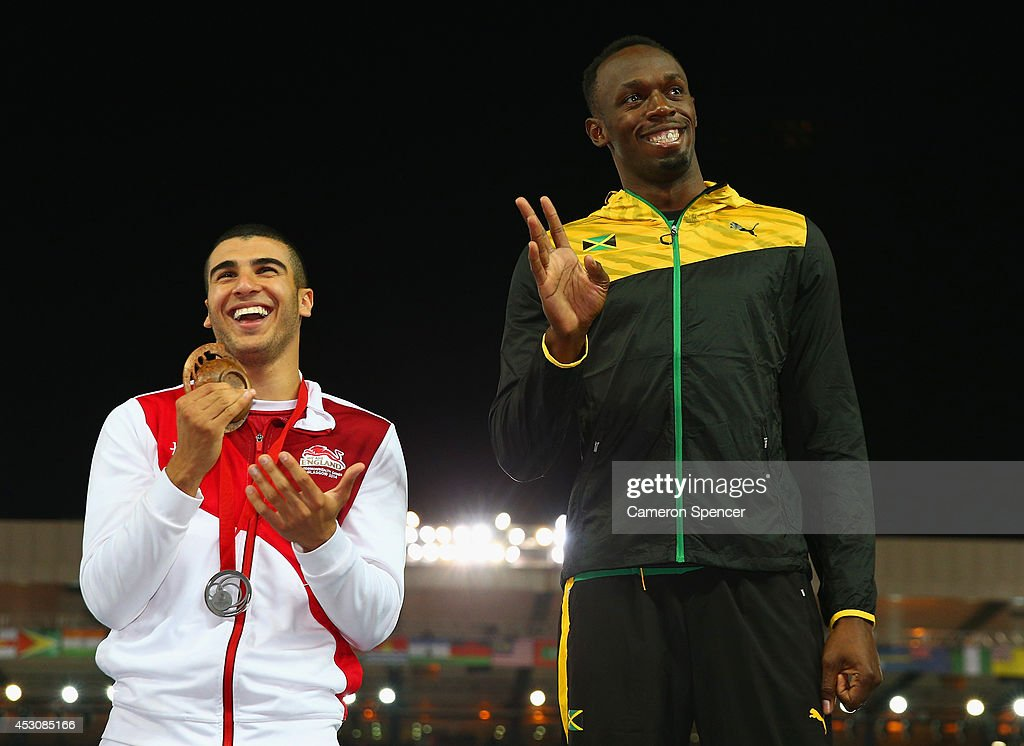 Silver medalist <a gi-track='captionPersonalityLinkClicked' href=/galleries/search?phrase=Adam+Gemili&family=editorial&specificpeople=7091483 ng-click='$event.stopPropagation()'>Adam Gemili</a> of England talks to gold medalist <a gi-track='captionPersonalityLinkClicked' href=/galleries/search?phrase=Usain+Bolt&family=editorial&specificpeople=604196 ng-click='$event.stopPropagation()'>Usain Bolt</a> of Jamaica during the medal ceremony for the Men's 4x100 metres relay at Hampden Park during day ten of the Glasgow 2014 Commonwealth Games on August 2, 2014 in Glasgow, United Kingdom.