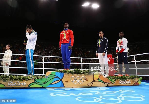 Silver medalist Adilbek Niyazymbetov of Kazakhstan gold medalist Julio Cesar La Cruz of Cuba bronze medalist Mathieu Albert Daniel Bauderlique of...
