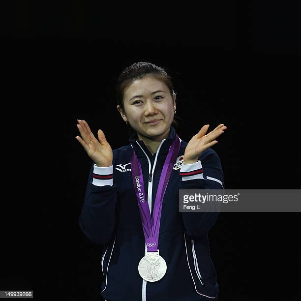 Silver medalist Ai Fukuhara of Japan celebrates on the podium during the medal ceremony for the Women's Team Table Tennis on Day 11 of the London...