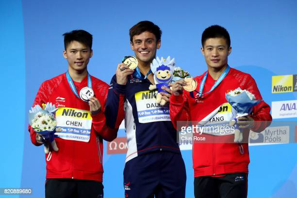 Silver medalist Aisen Chen of China gold medalist Tom Daley of Great Britain and bronze medalist Jian Yang of China pose with the medals won during...