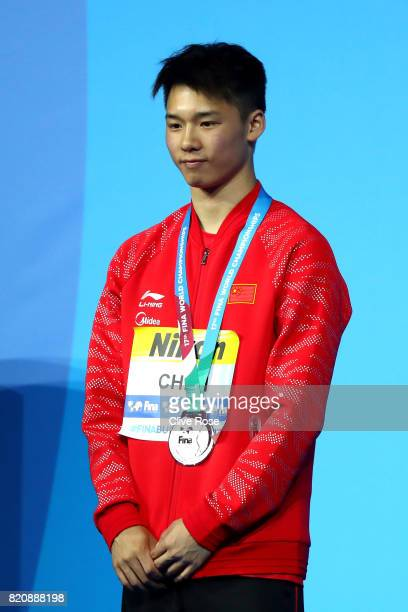 Silver medalist Aisen Chen of China poses with the medal won during the Men's 10M Platform final on day nine of the Budapest 2017 FINA World...