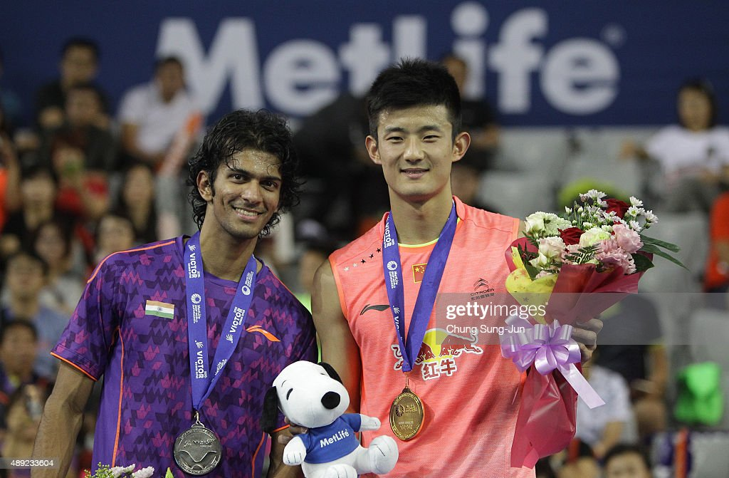 Silver medalist Ajay Jayaram of India and Gold medalist <a gi-track='captionPersonalityLinkClicked' href=/galleries/search?phrase=Chen+Long+-+Badminton+Player&family=editorial&specificpeople=9613842 ng-click='$event.stopPropagation()'>Chen Long</a> of China pose on the podium after the Men's Singles Final match of the 2015 Viktor Korea Badminton Open on September 20, 2015 in Seoul, South Korea.