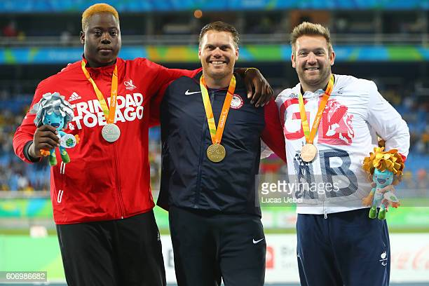 Silver medalist Akeem Stewart of Trinidad e Tobago gold medalist David Blair of United States and bronze medalist Dan Greaves of Great Britain pose...