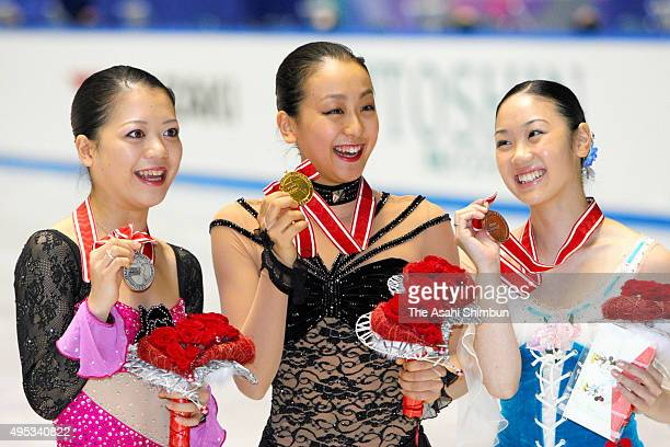 Silver medalist Akiko Suzuki gold medalist Mao Asada and bronze medalist Yukari Nakano of Japan pose on the podium at the medal ceremony for the...