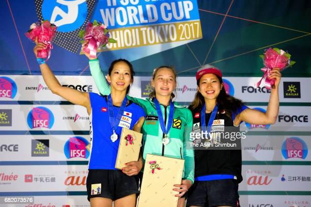 Silver medalist Akiyo Noguchi of Japan gold medalist Janja Garnbret of Slovenia and bronze medalist Miho Nonaka of Japan celebrate on the podium at...