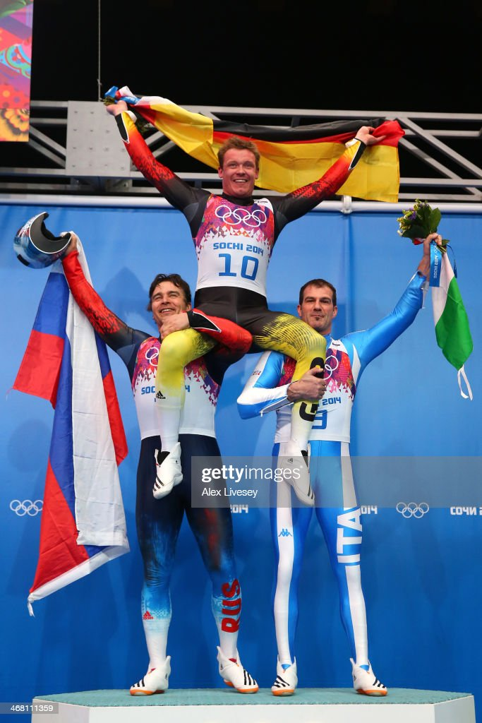 Silver medalist Albert Demchenko of Russia gold medalist Felix Loch of Germany and bronze medalist Armin Zoeggeler of Italy on the podium during the...