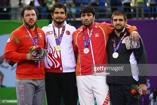 Silver medalist Aleksei Shemarov of Belarus gold medalist Taha Akgul of Turkey and bronze medalists Jamaladdin Magomedov of Azerbaijan and Geno...