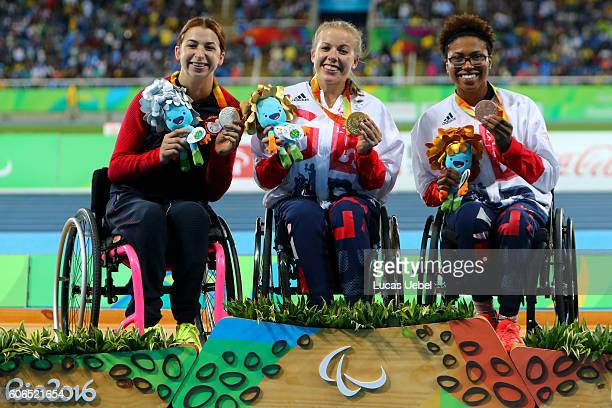 Silver medalist Alexa Halko of United States gold medalist Hannah Cockroft of Great Britain and bronze medalist Kare Adenegan of Great Britain pose...