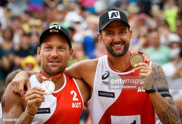 Silver Medalist Alexander Horst and Clemens Doppler of Austria pose for the photo during the medal ceremony for the Men's Final on August 06 2017 in...