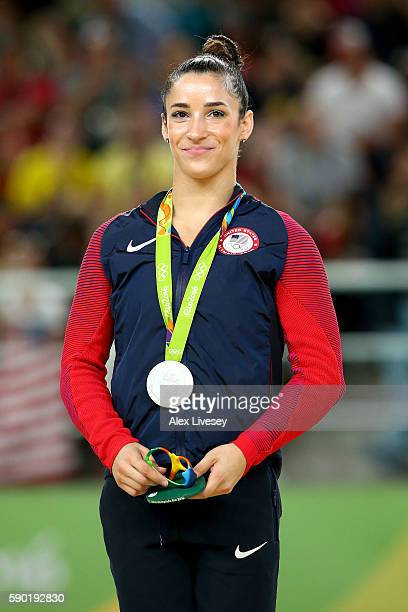 Silver medalist Alexandra Raisman celebrates on the podium at the medal ceremony for the Women's Floor on Day 11 of the Rio 2016 Olympic Games at the...