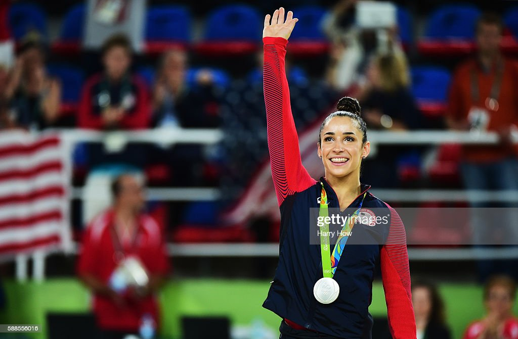 Silver medalist Alexandra Raisman of the United States celebrates on the podium at the medal ceremony for the Women's Individual All Around Final on...