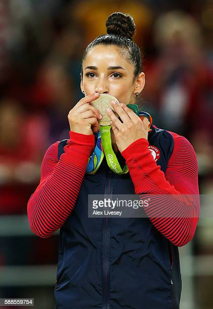 Silver medalist Alexandra Raisman of the United States kisses the medal on the podium at the medal ceremony for the Women's Individual All Around on...