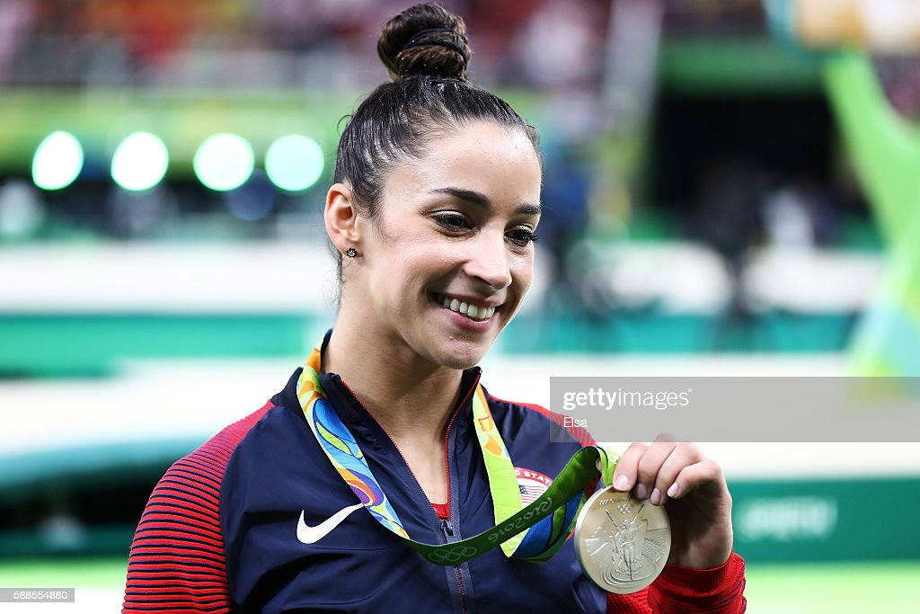 Silver medalist Alexandra Raisman of the United States poses for photographs after the medal ceremony for the Women's Individual All Around on Day 6...