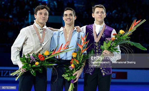 Silver medalist Alexei Bychenko of Israel gold medalist Javier Fernandez of Spain and bronze medalist Maxim Kovtun of Russia pose during the medal...