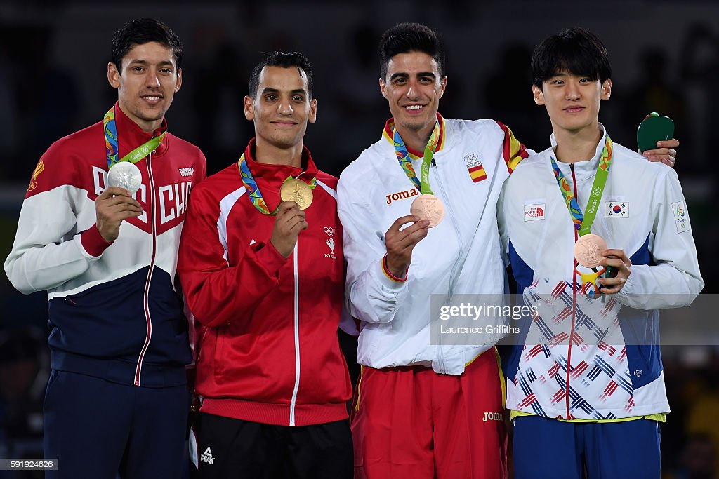 Silver medalist Alexey Denisenko of Russia, gold medalist Ahmad Abughaush of Jordan, Bronze medalists Daehoon Lee of the Republic of Korea and Joel Gonzalez Bonilla of Spain celebrate on the podium after the men's -68kg Taekwondo contests at the Carioca Arena on Day 13 of the 2016 Rio Olympic Games on August 18, 2016 in Rio de Janeiro, Brazil.