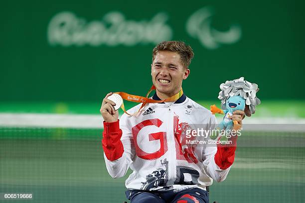 Silver medalist Alfie Hewett of Great Britain celebrates on the podium at the medal ceremony for the Men's Singles Wheelchair Tennis during day 9 of...