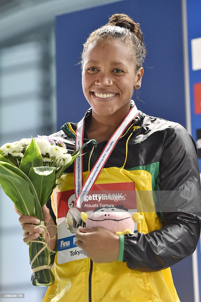 Silver Medalist <a gi-track='captionPersonalityLinkClicked' href=/galleries/search?phrase=Alia+Atkinson&family=editorial&specificpeople=881789 ng-click='$event.stopPropagation()'>Alia Atkinson</a> of Jamaica celebrates on the podium after the Women's 100m Individual Medley Final during FINA/MASTBANK Swimming World Cup 2014 at Tokyo Tatsumi International Swimming Pool on October 29, 2014 in Tokyo, Japan.