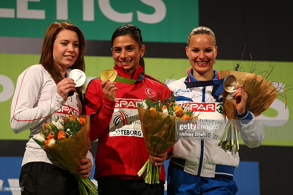 Silver medalist Alina Talay of Belarus, Gold medalist Nevin Yanit of Turkey and bronze Veronica Borsi of Italy pose during the victory ceremony for the Women's 60m Hurdlesduring day one of the European Athletics Indoor Championships at Scandinavium on March 1, 2013 in Gothenburg, Sweden.