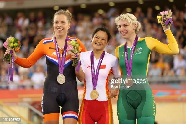 Silver medalist Alyda Norbruis of Netherlands Gold medalist Yin He of China and bronze medalist Jayme Paris of Australia pose on the podium during...