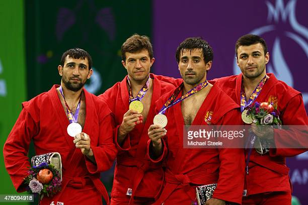 Silver medalist Amil Gasimov of Azerbaijan gold medalist Stsiapan Papou of Belarus bronze medalist Kakha Mamulashvili of Georgia and bronze medalist...