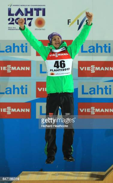 Silver medalist Andreas Wellinger of Germany celebrates during the flower ceremony for the Men's Ski Jumping HS130 at the FIS Nordic World Ski...